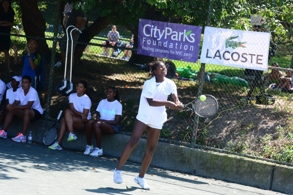 Isis Gill playing at the CityParks Tennis Lacoste Pro Clinic in 2013